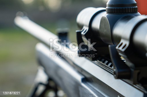 Close up modern sniper rifle, military conflict, concept of war.
