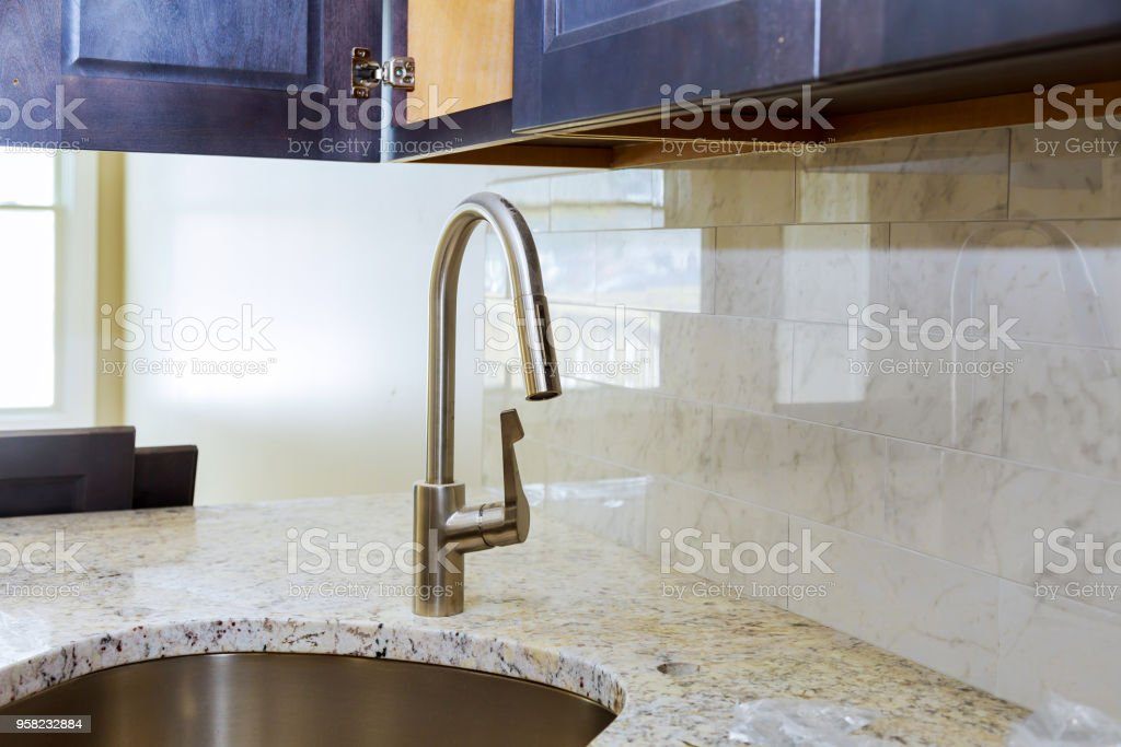 Close Up Of Modern Stylish Stainless Steel Kitchen Sink Stock