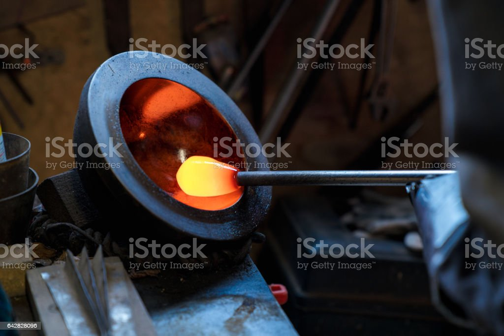 Close up of molten glass being shaped before being blown stock photo