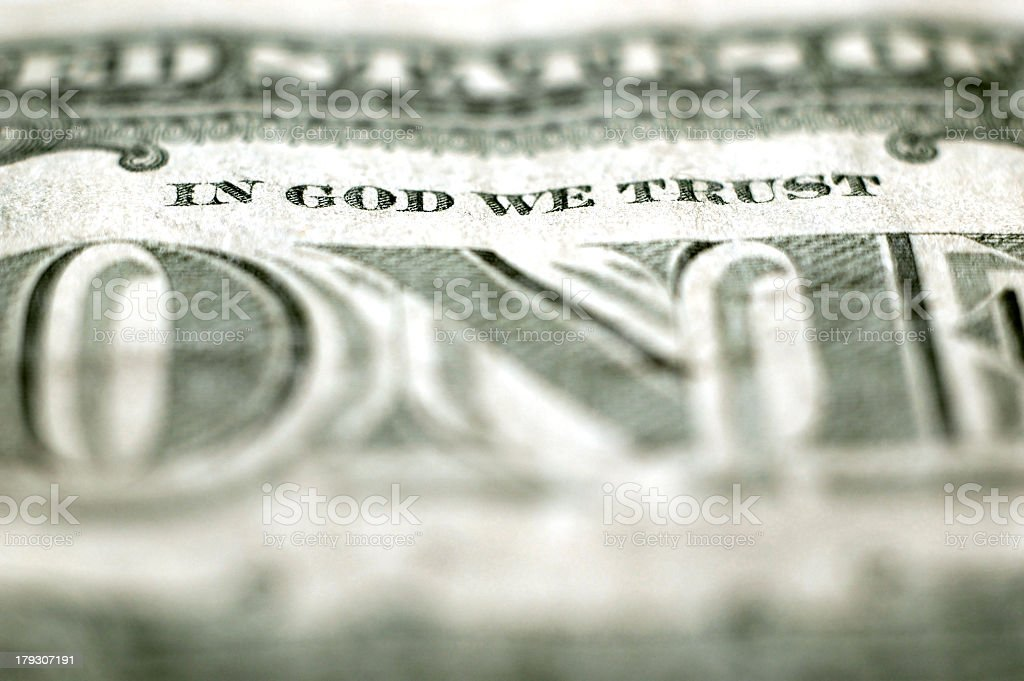 Close up of money In God We Trust royalty-free stock photo