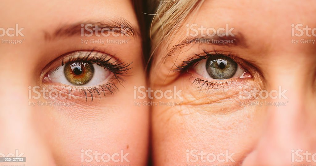 Close Up Of Mother And Daughter Faces Together stock photo