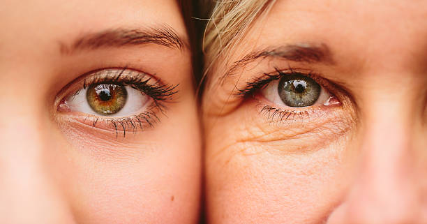 close up of mother and daughter faces together - eye stock pictures, royalty-free photos & images