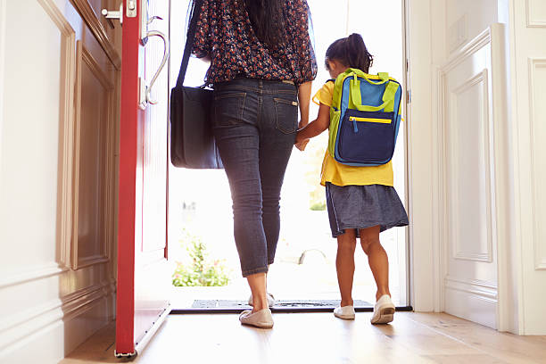 close up of mother and daughter leaving for school - leaving stock photos and pictures