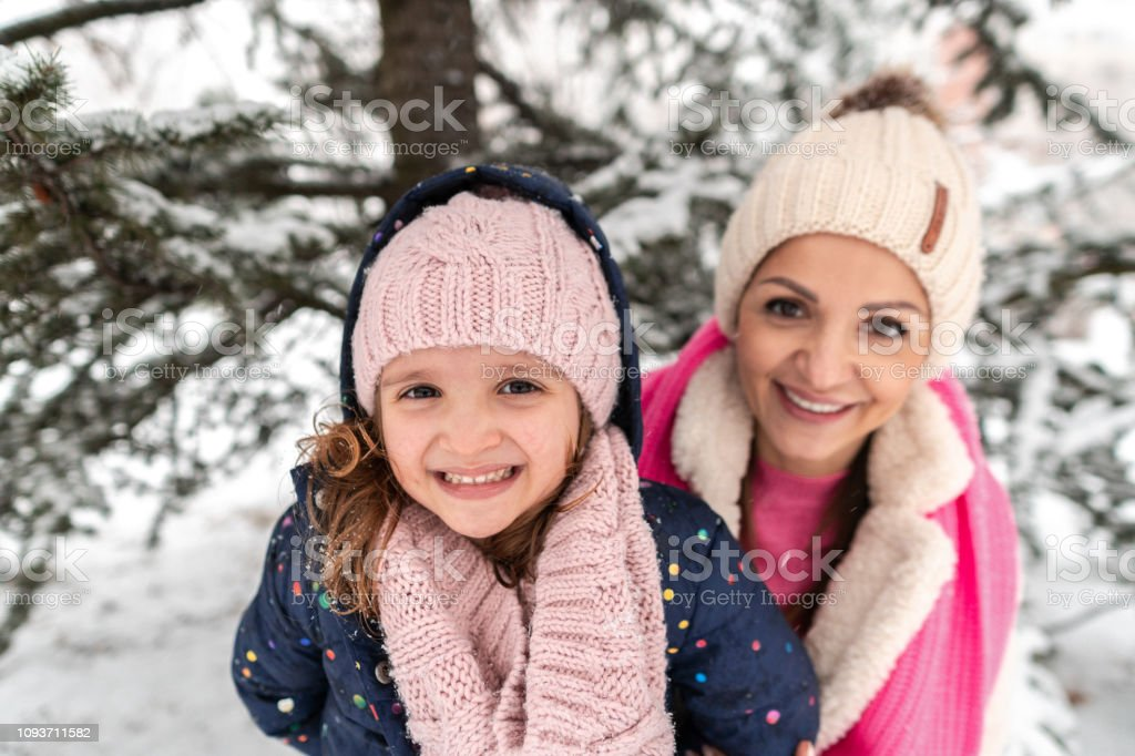 Close up of Mother and Daughter on a Snowy Day stock photo