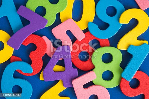 istock Close up of multicolored wooden numbers back to school abstract. 1135400792