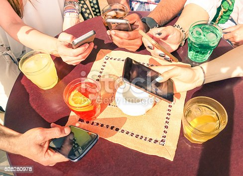 istock Close up of multiracial friend hands with mobile smart phones 528280978