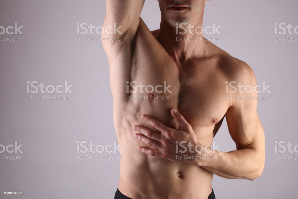 Close up of muscular male torso, chest and armpit hair removal. Male Waxing stock photo