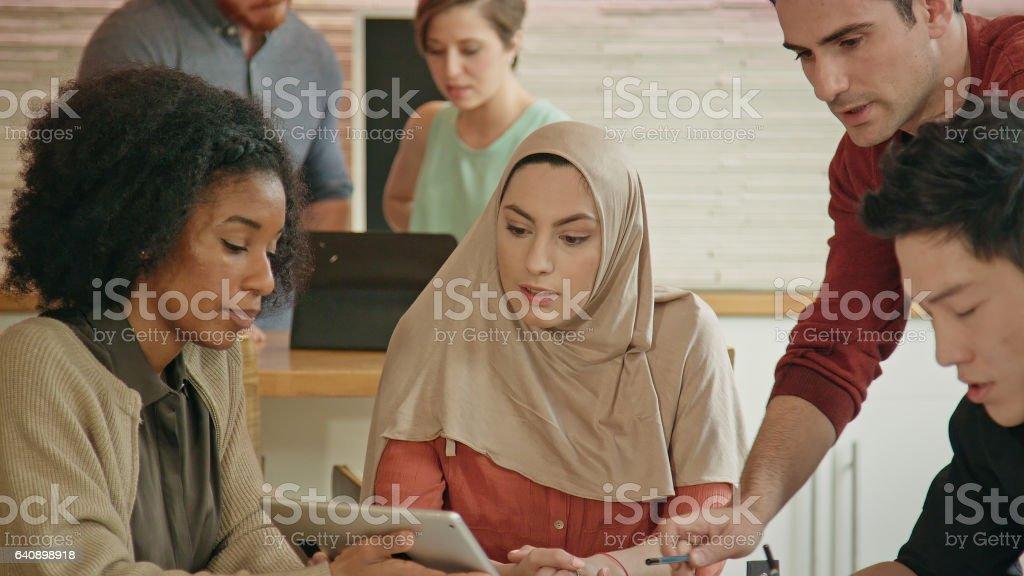 Close Up of Muslim Businesswoman Leading a Multi-Ethnic Team stock photo