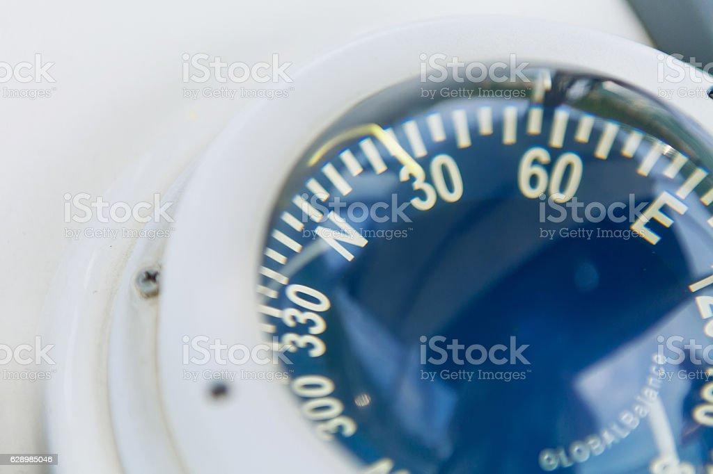 Close up of nautical compass stock photo