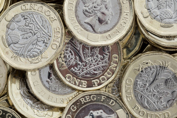 Close up of new British pound coins. stock photo