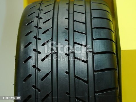 496485590istockphoto Close up of new tire in a row 1139926918