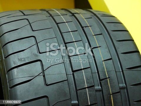 496485590istockphoto Close up of new tire in a row 1139926922