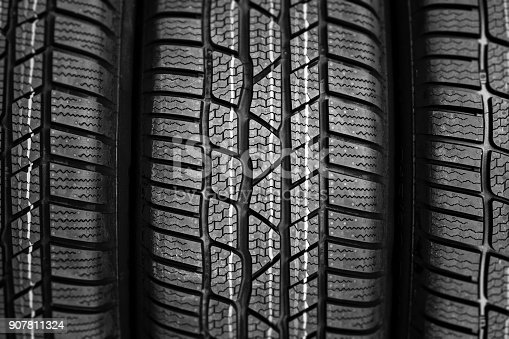 istock close up of new tire in a row 907811324