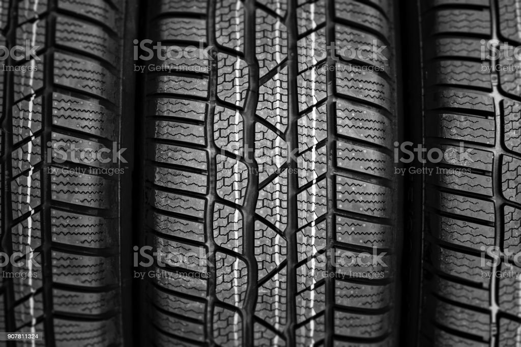 close up of new tire in a row stock photo