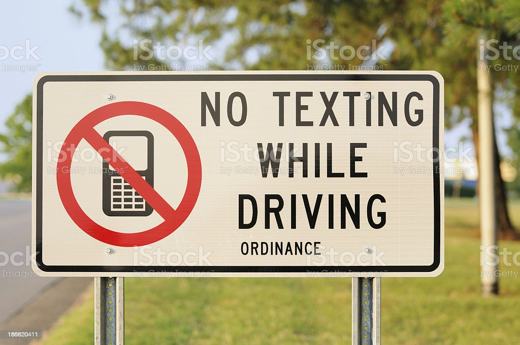 Close up of no texting while driving sign royalty-free stock photo