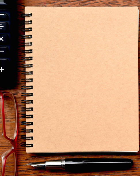 close up of notebook with pen, glasses and calculator – zdjęcie