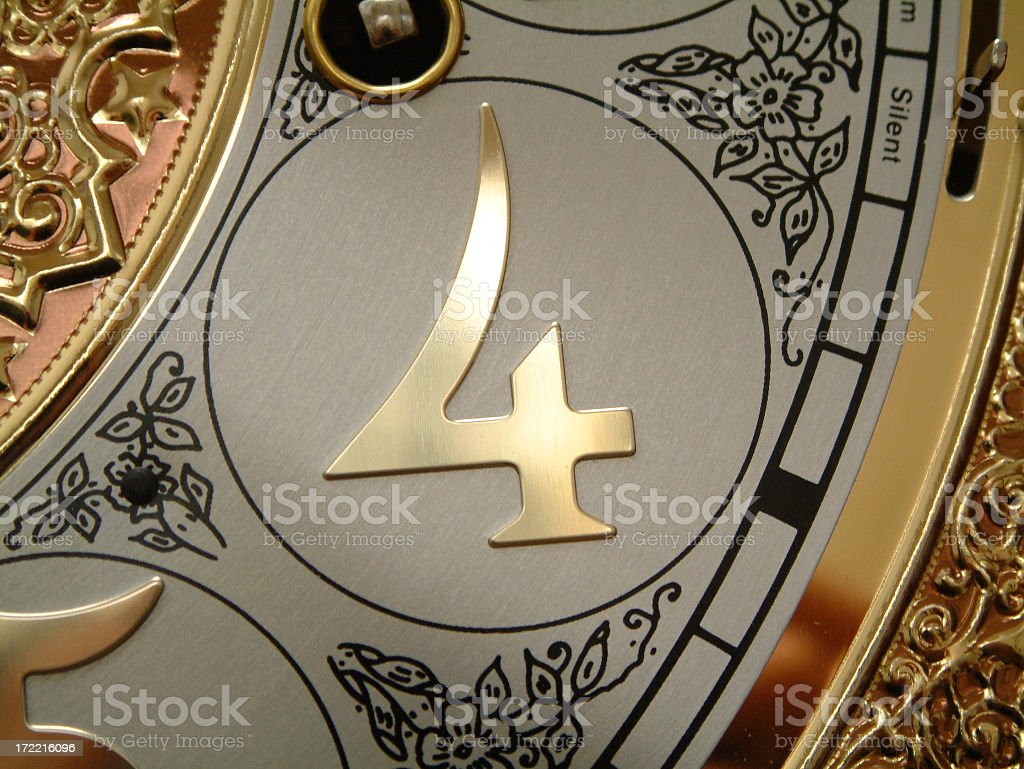 Close up of number four on an antique clock royalty-free stock photo