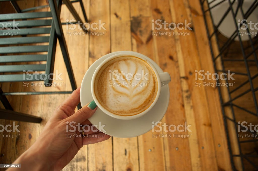 Close up of of coffee cup and hands. stock photo