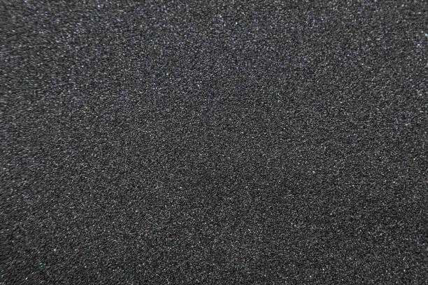 Nahaufnahme von der Skateboard-Griptape. Makroaufnahme von Schleifpapier Textur – Foto