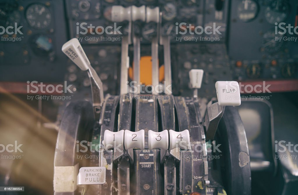 Close up of old airline throttle console stock photo