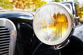 Close up of old head lights on rarity car front