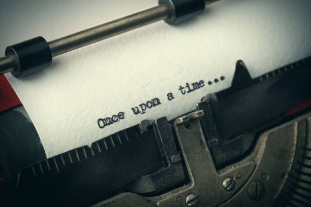 close up of old typewriter covered with dust with once upon a time text - fairy tale stock pictures, royalty-free photos & images