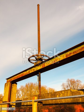 close up of old waterworks wheel bridge damn; essex; england; uk