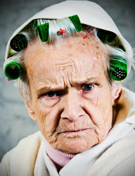 Close up of old Women with curlers and dressing gown stock photo