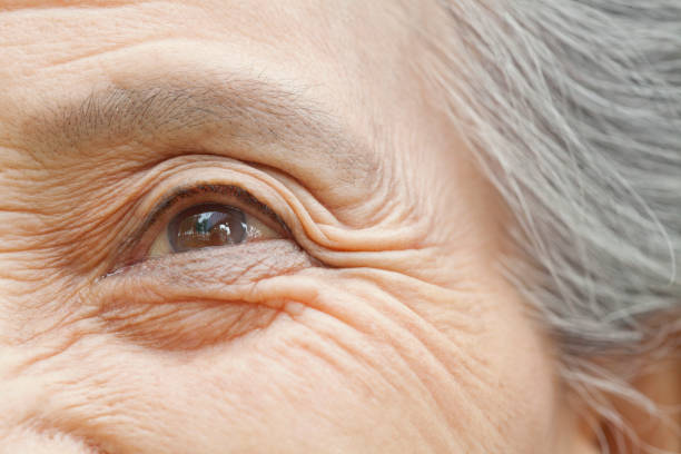 Close up of older Chinese woman's eye stock photo