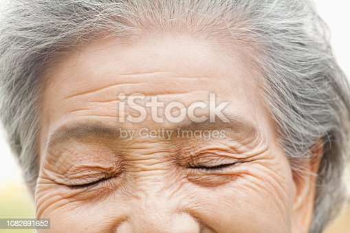 istock Close up of older Chinese woman's eyes 1082691652