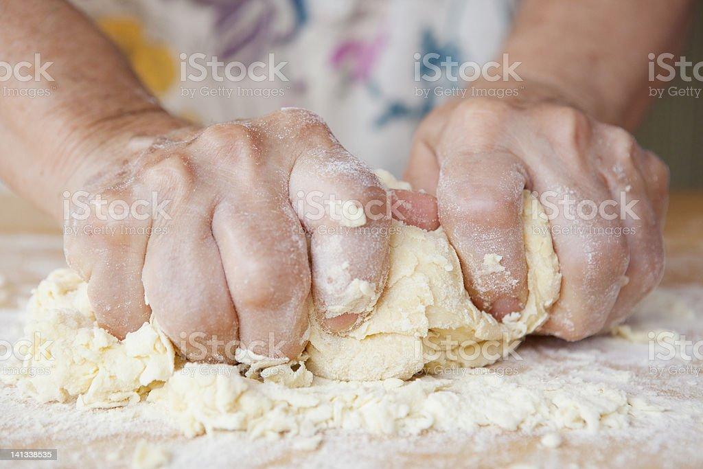 Close up of older woman kneading dough stock photo