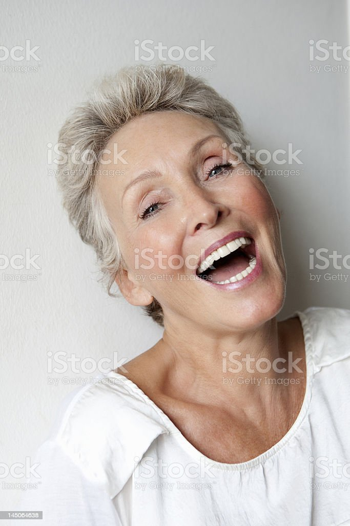 Close up of older womans smiling face stock photo