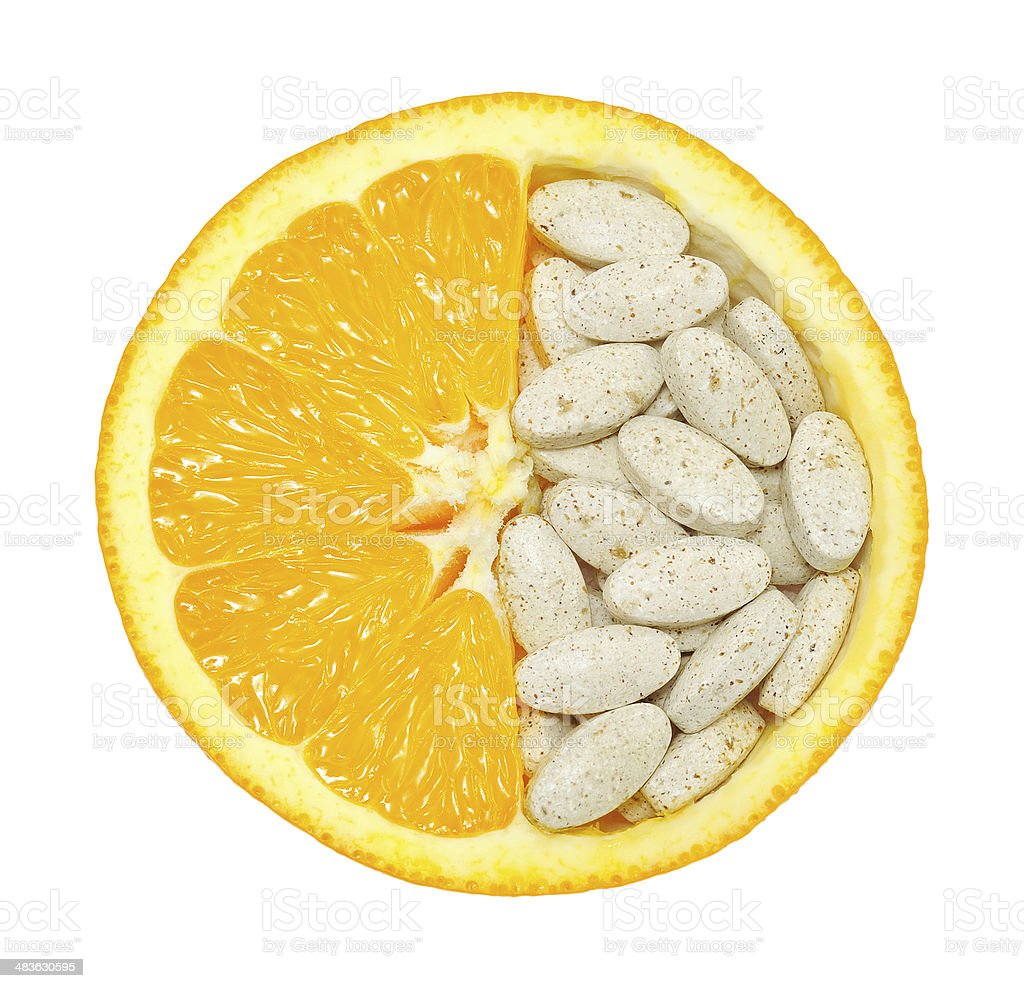 Close up of orange fruit and pills isolated royalty-free stock photo