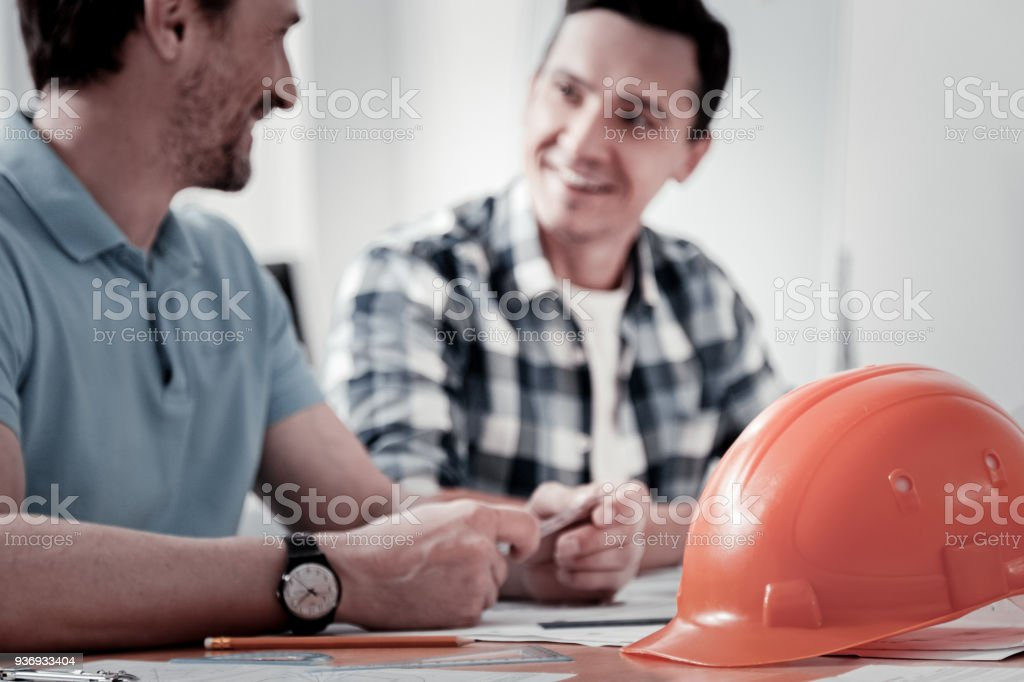 Close up of orange helmet that being ready for usage stock photo