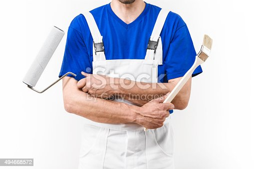 589454570 istock photo Close up of painter man with paint roller and brush 494668572