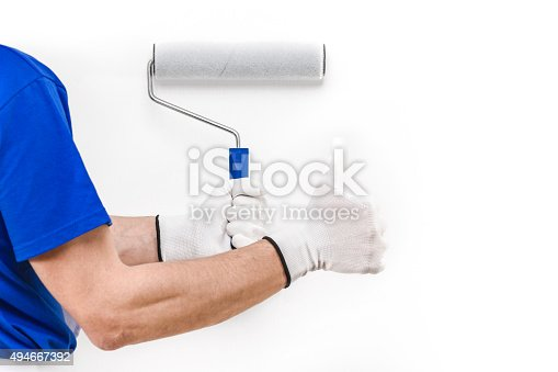 589454570 istock photo Close up of painter man with paint roller doing ok 494667392