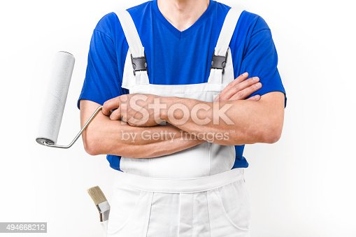 589454570 istock photo Close up of painter man with paint roller. 494668212
