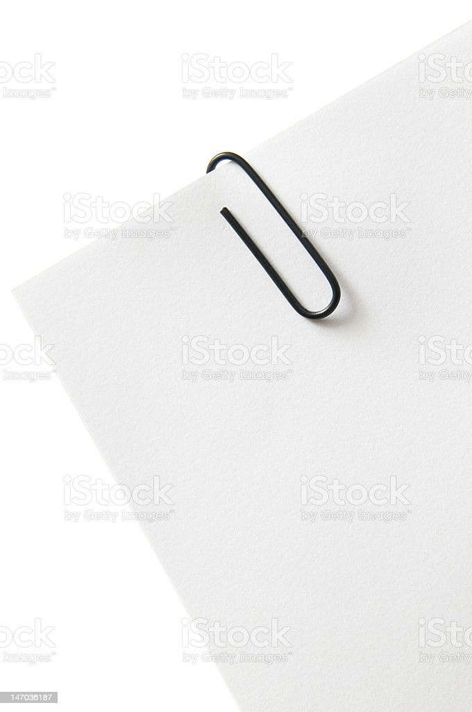 Close up of paper clip holding some papers royalty-free stock photo