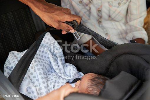 istock Close Up Of Parents Bringing Newborn Baby Home In Car 670917166