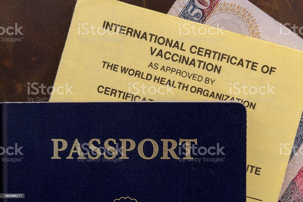 Close up of passport and vaccination card stock photo