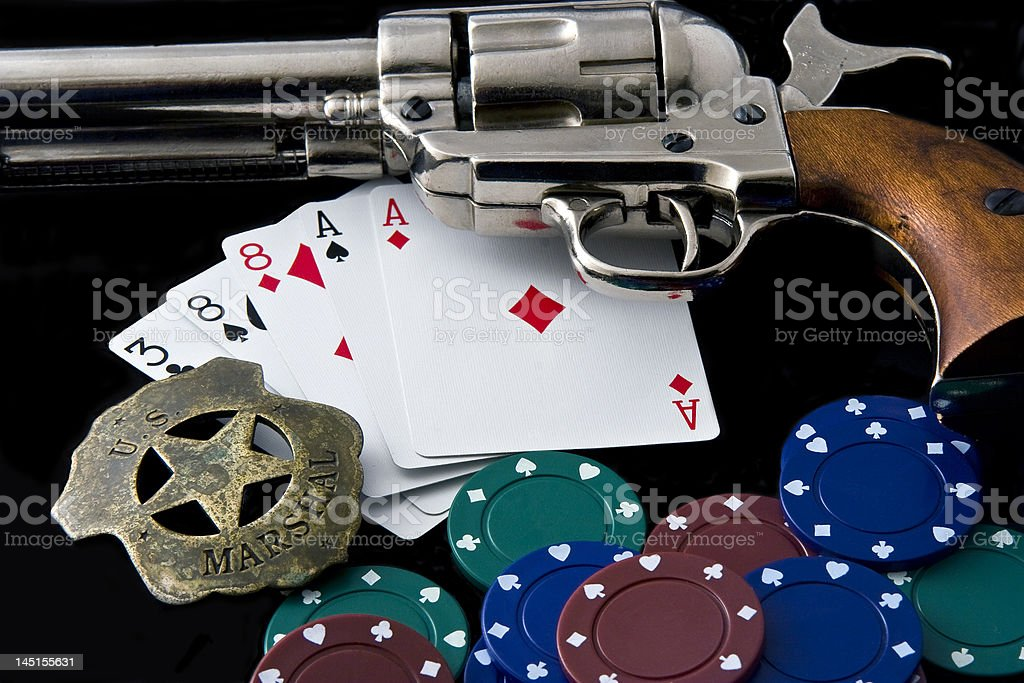 Close up of Peacemaker, Marshal Badge, Chips and  playing cards royalty-free stock photo