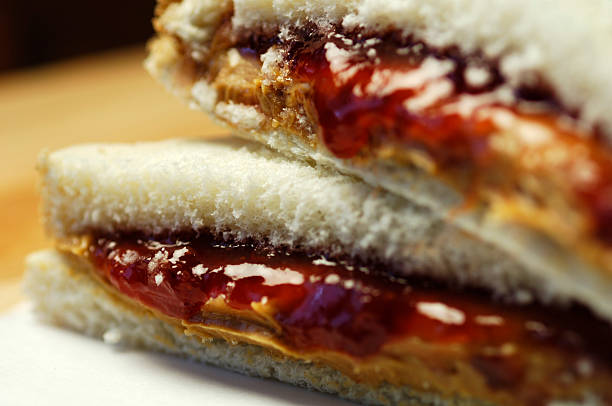 making a perfect sandwich using peanut butter and jelly