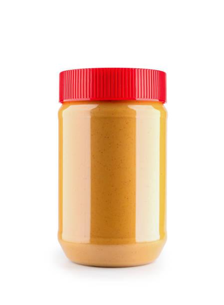 close-up van pindakaas fles mockup geïsoleerd op witte achtergrond, bestand bevat een knippad. - pindakaas stockfoto's en -beelden