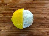 Lemon peel on a white background, close-up. Lemon twist.