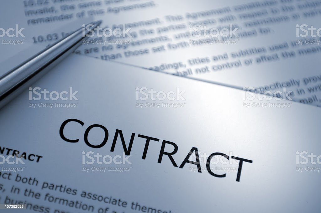 Close Up of Pen on Contract stock photo