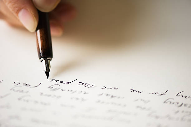 Close up of pen writing a letter stock photo