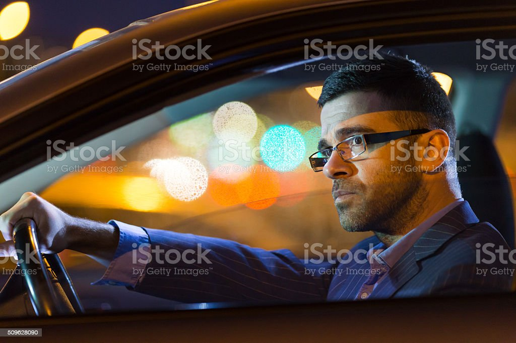 Close up of pensive young man driving his car stock photo