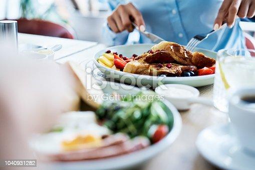 Close up of people having breakfast in restaurant