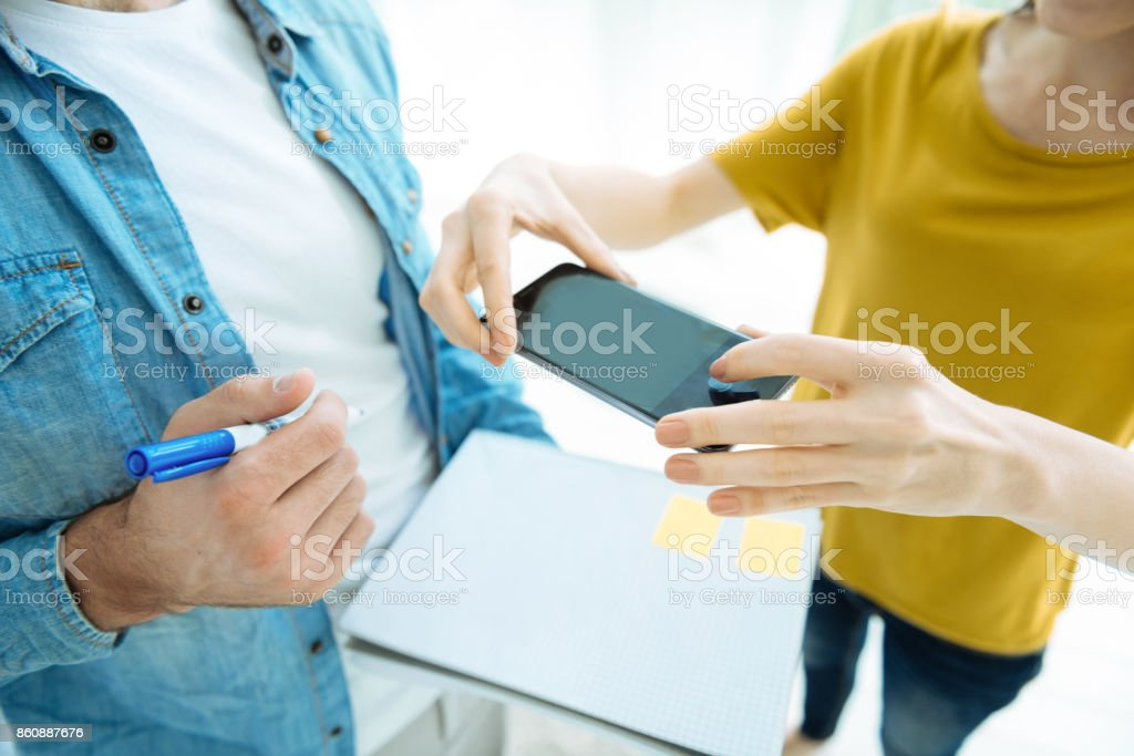 Close up of people photographing notes in notebook stock photo