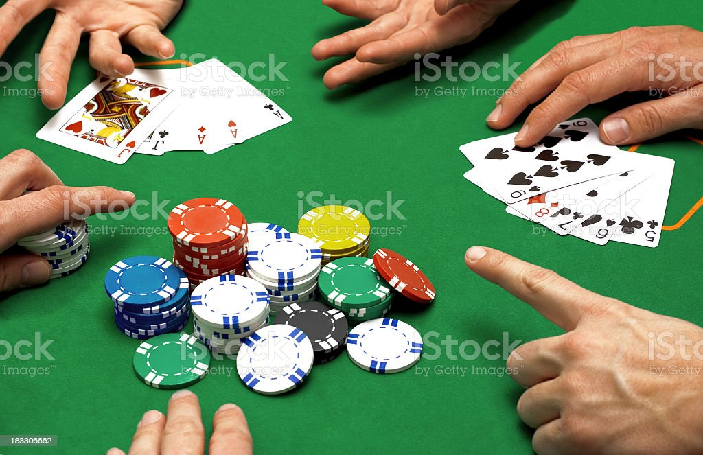 Close up of people playing poker stock photo